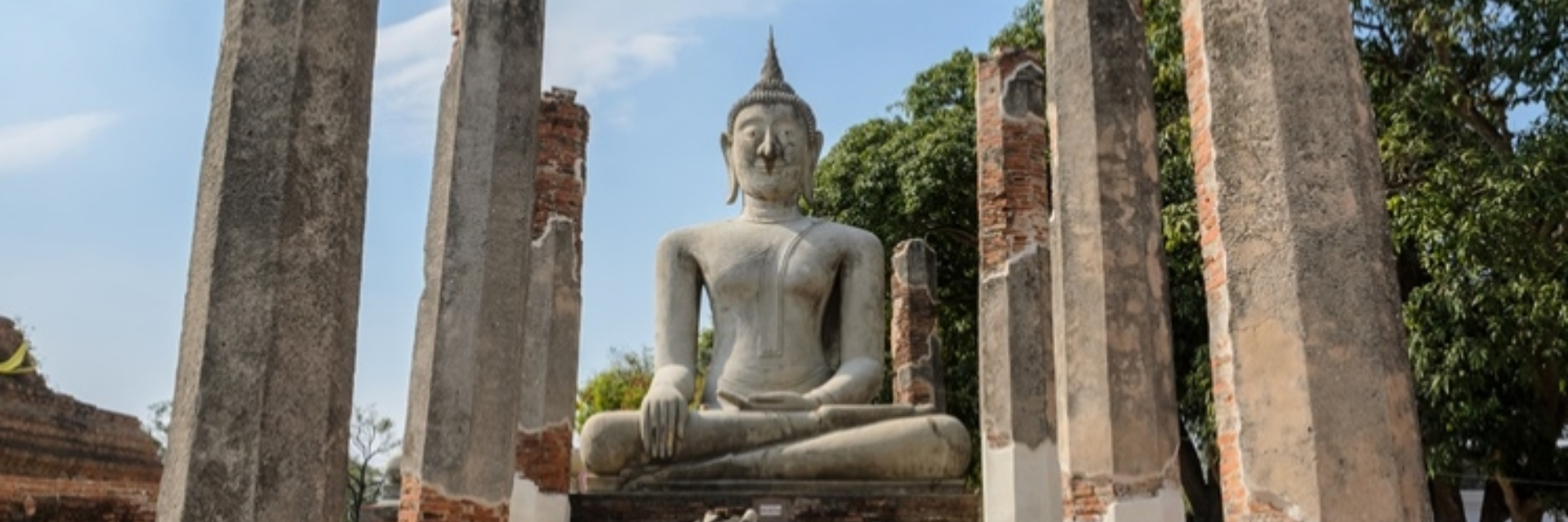 THE ANCIENT BUDDHA STATUE. WAT MAHATHAT, CHAINAT